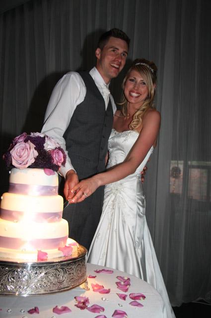 Wedding photographer Essex - cutting the cake