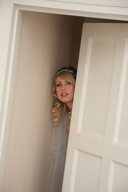 Essex photographer - bride in doorway